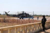 An attack helicopter is seen in the Mocimboa da Praia airport