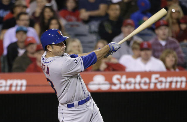 New York Mets' Josh Satin hits a two-RBI double during the fourth inning of a baseball game against the Los Angeles Angels, Friday, April 11, 2014, in Anaheim, Calif. (AP Photo/Jae C. Hong)