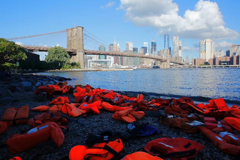 Life jackets collected from the beaches of Chios, Greece, are displayed at the Brooklyn Bridge park ahead of the UN Summit for Refugees and Migrants in New York