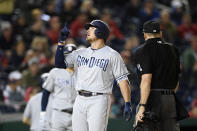 San Diego Padres' Hunter Renfroe points as he celebrates his home run during the ninth inning of a baseball game against the Washington Nationals, Friday, April 26, 2019, in Washington. (AP Photo/Nick Wass)