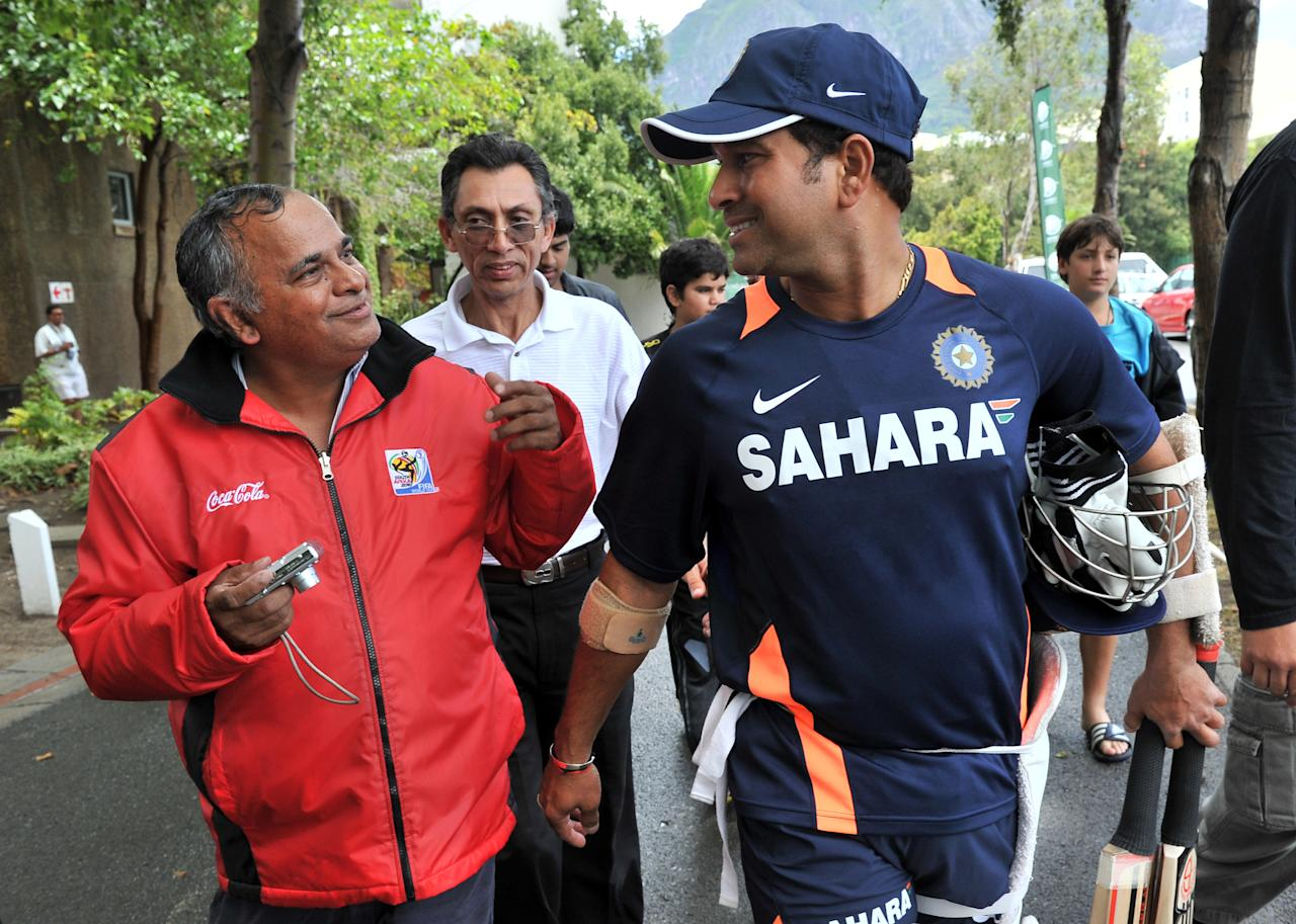 Indian superstar cricketer Sachin Tendulkar (R) talks to fans during a training session at Newlands Stadium in Cape Town on January 1, 2011 on the eve of the third test between South Africa and India.  AFP PHOTO / ALEXANDER JOE (Photo credit should read ALEXANDER JOE/AFP/Getty Images)