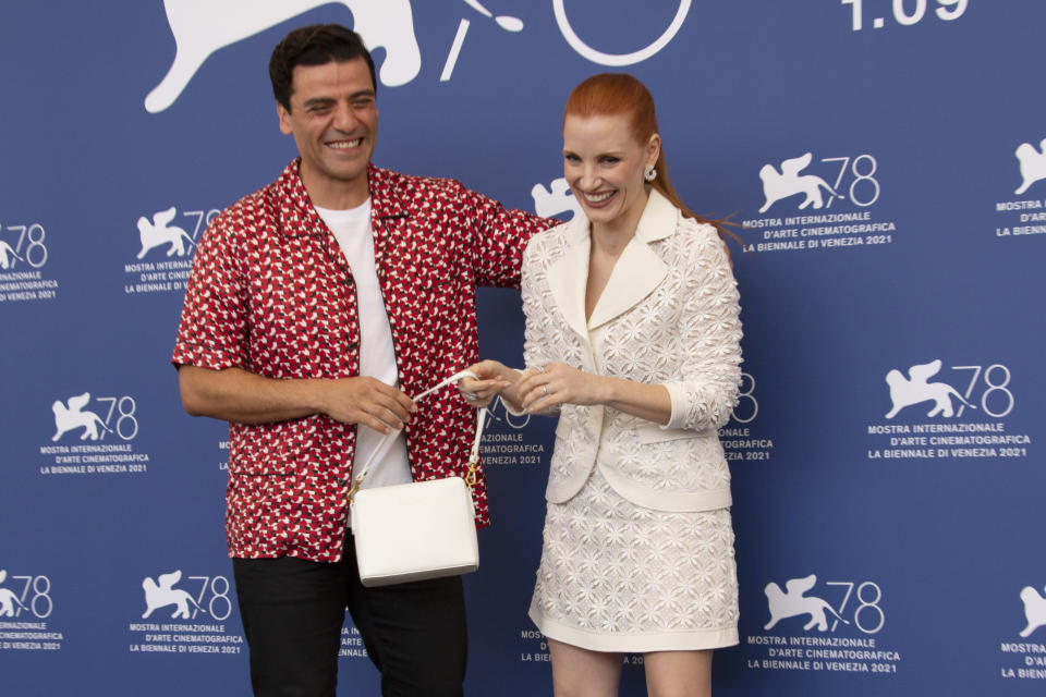 Oscar Isaac, left, and Jessica Chastain pose for photographers at the photo call for the film 'Scenes of a Marriage' during the 78th edition of the Venice Film Festival in Venice, Italy, Saturday, Sep, 4, 2021. (Photo by Joel C Ryan/Invision/AP)