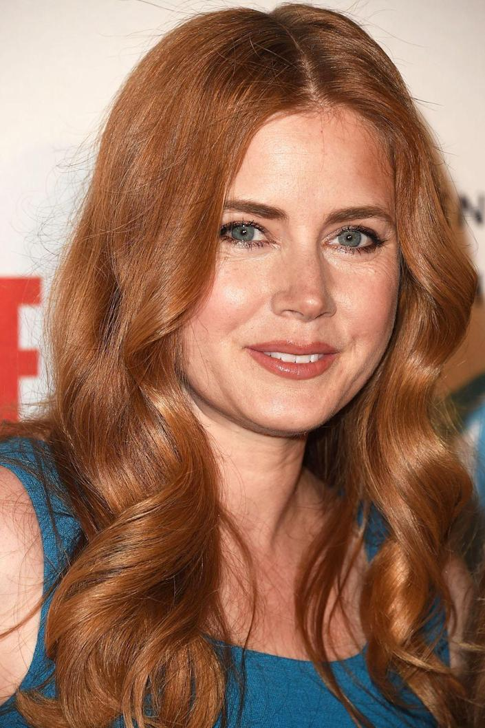 """<p>Amy Adams <a href=""""http://www.goodhousekeeping.com/beauty/hair/g4590/celebrity-signature-hairstyles/"""" rel=""""nofollow noopener"""" target=""""_blank"""" data-ylk=""""slk:has stuck to long red locks"""" class=""""link rapid-noclick-resp"""">has stuck to long red locks</a> for as long as she's been a household name.</p>"""