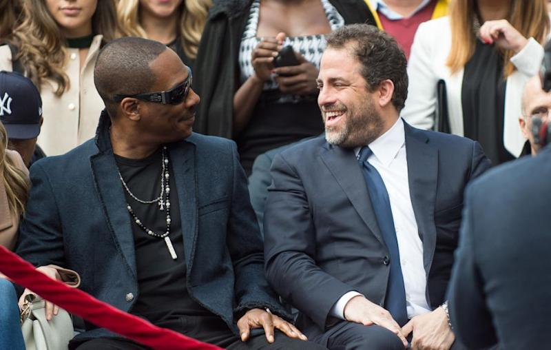The Hollywood bigshot is seen here with Eddie Murphy. It was the unveiling of Ratner's Hollywood star. Source: Getty