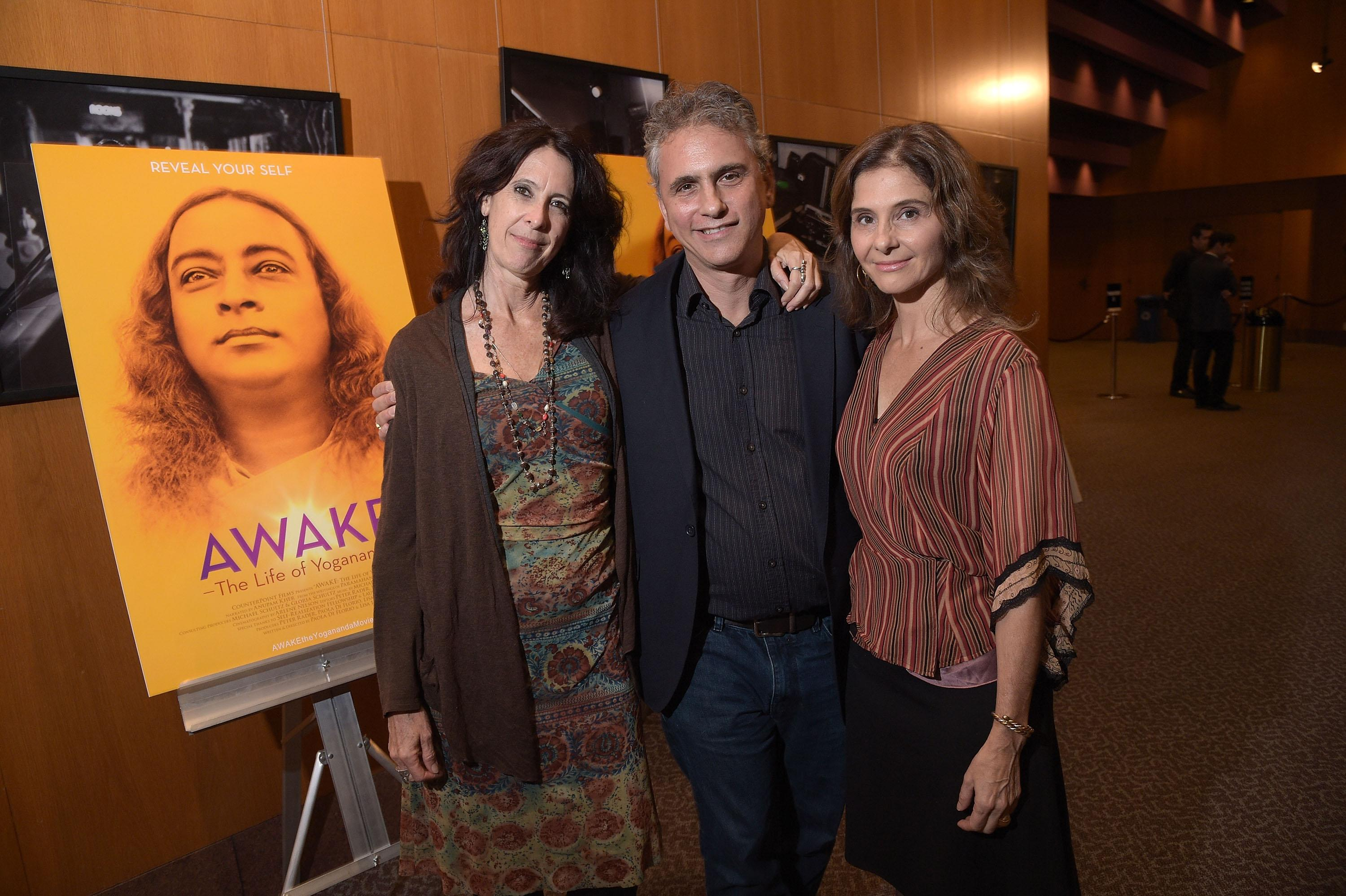 "LOS ANGELES, CA - OCTOBER 13: Director Lisa Leeman, producer Peter Rader and director Paola di Florio attend the premiere of ""Awake"" at Directors Guild Of America on October 13, 2014 in Los Angeles, California. (Photo by Jason Kempin/Getty Images)"