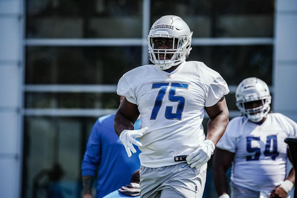 Lions defensive lineman Levi Onwuzurike works out during rookie minicamp in Allen Park on Sunday, May 16, 2021.