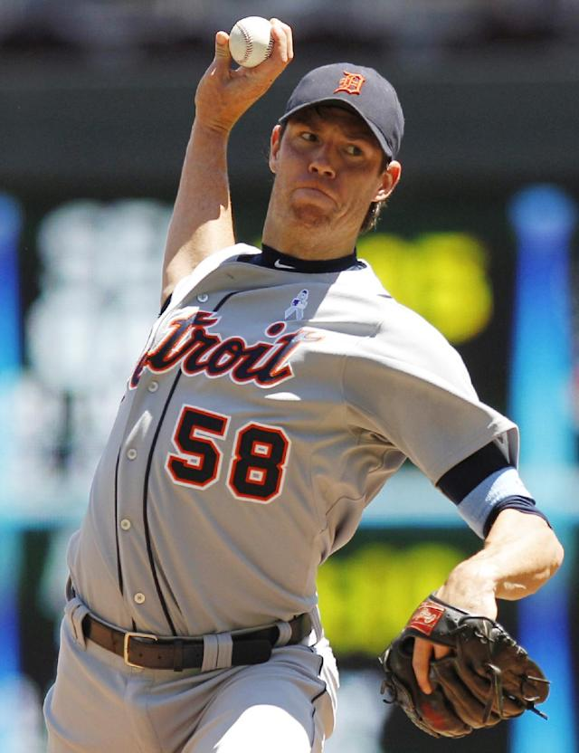 Detroit Tigers starting pitcher Doug Fister (58) throws against the Minnesota Twins during the third inning of a baseball game on Sunday, June 16, 2013, in Minneapolis. (AP Photo/Genevieve Ross)