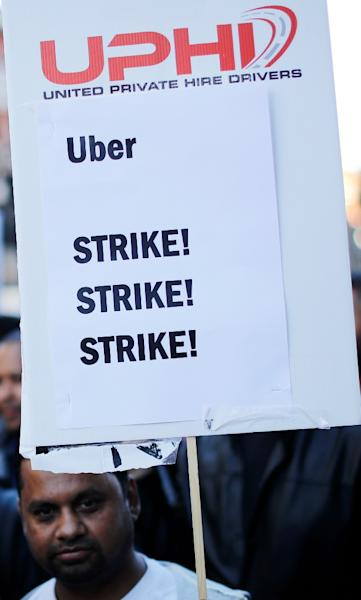 Uber drivers in Britain have been demanding better rights (AFP Photo/Tolga AKMEN)