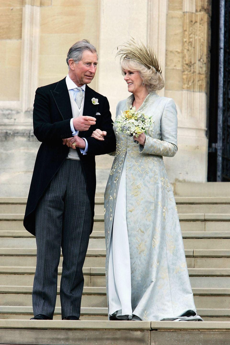 <p>Camilla, Duchess of Cornwall, wore a blue-gold dress coat by Robinson Valentine, which was inspired by her mother's jewelry, for her exchanging of vows with Prince Charles. She wore a headpiece by Philip Treacy. </p>