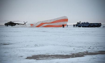 Search and rescue team works on the site of landing of the Soyuz MS-06 space capsule with International Space Station crew members Joe Acaba and Mark Vande Hei of the U.S., and Alexander Misurkin of Russia in a remote area outside the town of Dzhezkazgan (Zhezkazgan), Kazakhstan, on February 28, 2018.  REUTERS/Alexander Nemenov/Pool