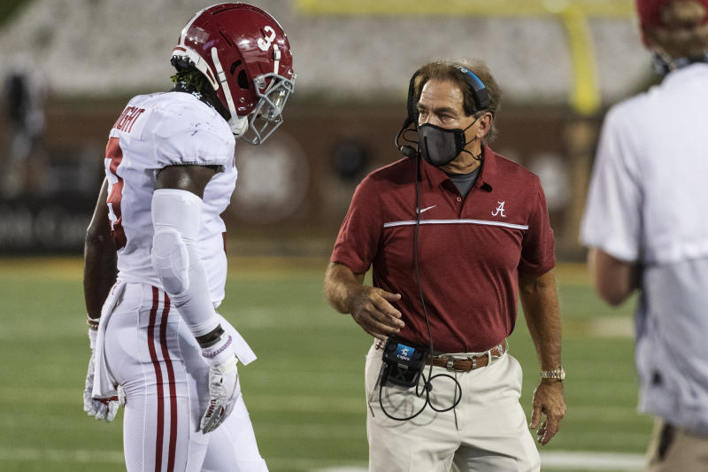 Alabama head coach Nick Saban, right, talks to Daniel Wright as he goes off the field during the second half of a football game at NCAA College against Missouri on Saturday, September 26, 2020, in Columbia, Mo.  (AP Photo / LG Patterson)