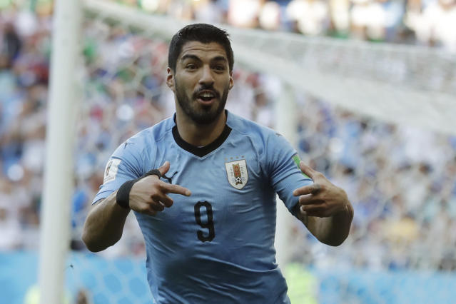 Uruguay's Luis Suarez celebrates scoring his side's first goal during the group A match against Saudi Arabia at the 2018 soccer World Cup in Rostov Arena in Rostov-on-Don, Russia, Wednesday, June 20, 2018. (AP Photo/Andrew Medichini)