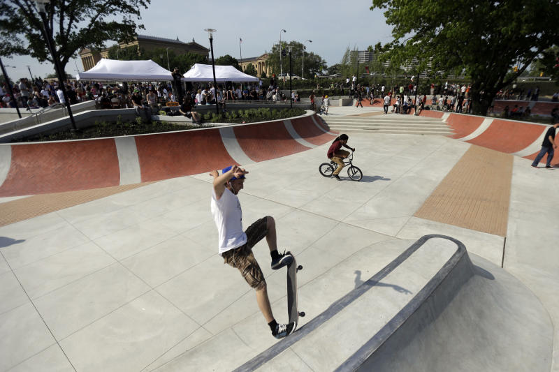 A skateboarder rides a ramp at Paine's Park, Wednesday, May 22, 2013, in Philadelphia. The $4.5 million space, which has been about a dozen years in the making, officially opened to boarders after a ribbon-cutting Wednesday. (AP Photo/Matt Rourke)