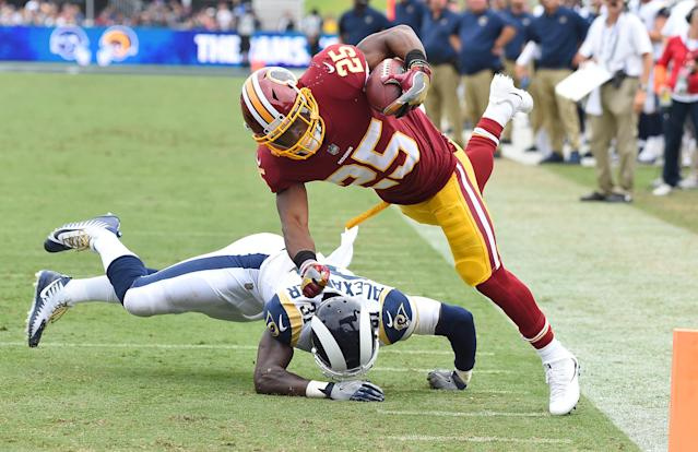 <p>Washington Redskins running back Chris Thompson (25) is upended by Los Angeles Rams strong safety Maurice Alexander (31) as he flies past the goal marker for a touchdown in the second quarter of the game at the Los Angeles Memorial Coliseum. Mandatory Credit: Jayne Kamin-Oncea-USA TODAY Sports </p>