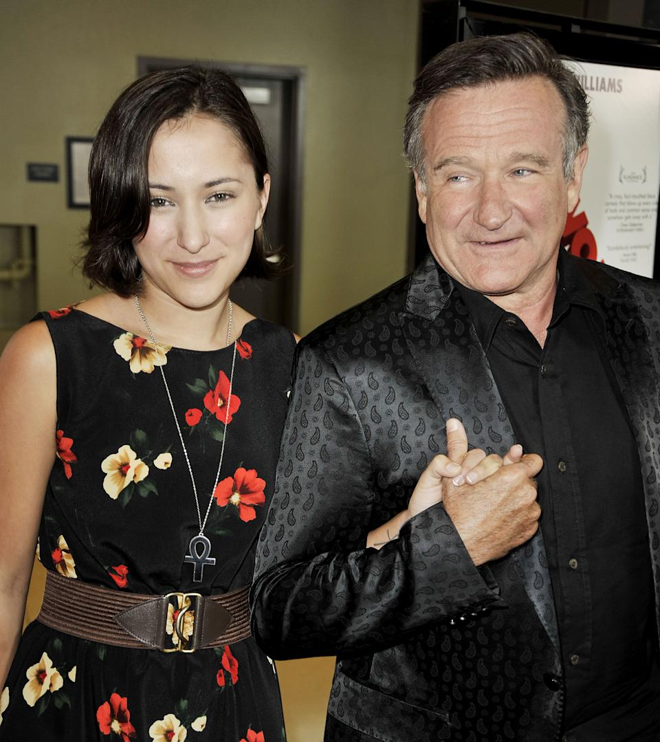 """LOS ANGELES, CA - AUGUST 13:  Actress Zelda Williams (L) and her father actor Robin Williams arrive at the premiere of Magnolia Pictures' """"World's Greatest Dad"""" at The Landmark Theater on August 13, 2009 in Los Angeles, California.  (Photo by Kevin Winter/Getty Images)"""