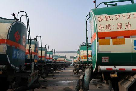 Oil tankers are seen in Shandong Haike Group in Dongying