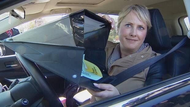 Sheila Johnstone with the City of Calgary displays one of the mobile privacy folders Calgarians used to vote in the 2017 municipal election. Strathcona County plans to use a similar system for its drive-thru voting station in the 2021 municipal election. (Monty Kruger/CBC - image credit)