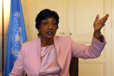 Outgoing U.N. Human Rights Commissioner Navi Pillay talks during an interview to Reuters in her office in Geneva