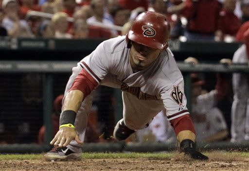 Arizona Diamondbacks' Gerardo Parra scores on a single by Paul Goldschmidt during the 14th inning of a baseball game against the St. Louis Cardinals Tuesday, June 4, 2013, in St. Louis. (AP Photo/Jeff Roberson)