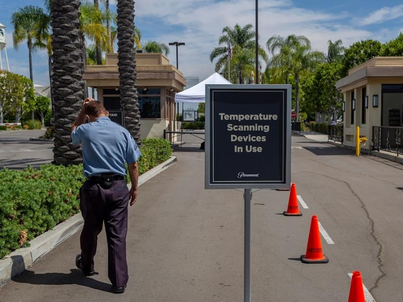 A security guard walks outside Paramount Pictures Studios as Los Angeles County allows more businesses and facilities to reopen today, despite rising COVID-19 infections and deaths on June 12, 2020 in Los Angeles, California.