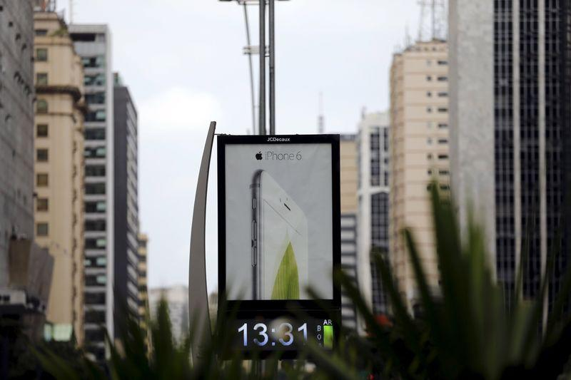 Advertisement board displays an iPhone 6 at Paulista avenue in Sao Paulo
