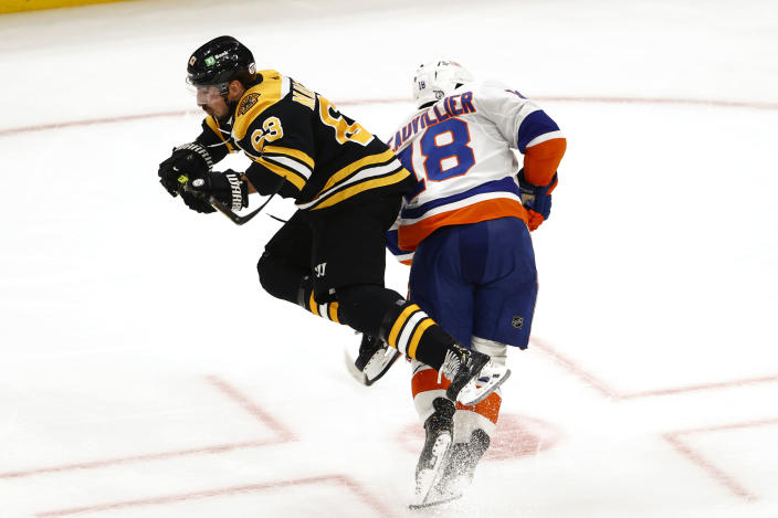 Boston Bruins' Brad Marchand, left, collides with New York Islanders' Anthony Beauvillier in the second period of Game 2 during an NHL hockey second-round playoff series, Monday, May 31, 2021, in Boston. (AP Photo/Winslow Townson)