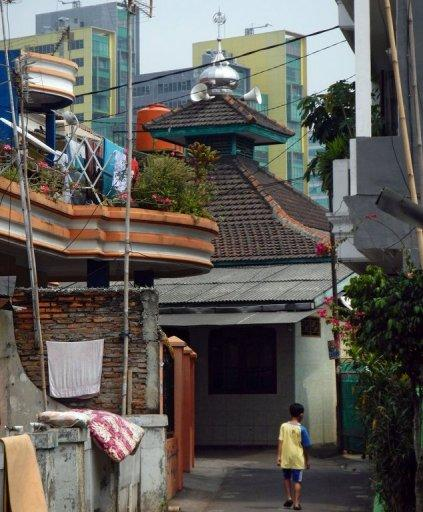 An Indonesian mosque among residential buildings and equipped with loudspeakers used to call the faithful to prayer in Jakarta. While Ramadan is regarded as one of the most spiritual periods in the Islamic calendar, for those who live close to Indonesia's mosques it is also the most noisy
