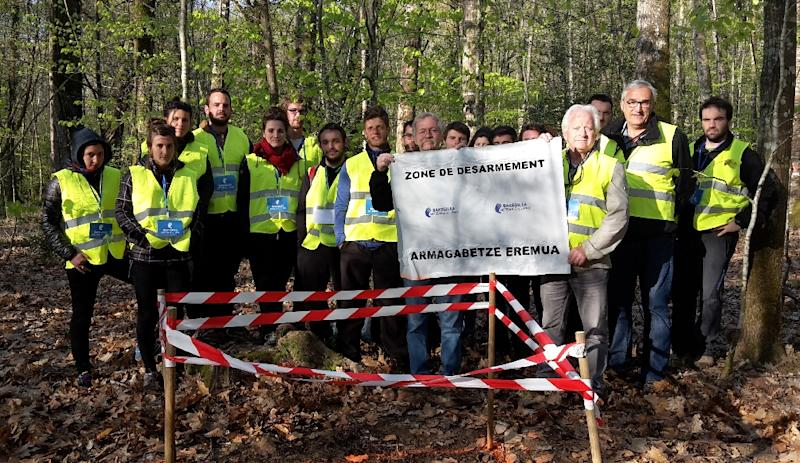 """MEP Jose Bove and other members of the """"Artisans of Peace"""" group at the site of an arms cache (AFP Photo/-)"""