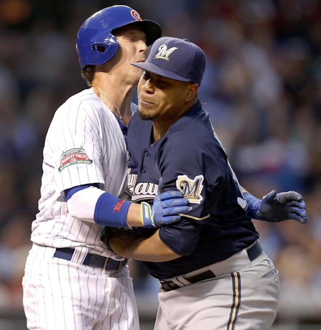 Chicago Cubs' Chris Coghlan, left, collides with Milwaukee Brewers starting pitcher Wily Peralta as Peralta tags Coghlan out on the first baseline during the third inning of a baseball game Tuesday, Aug. 12, 2014, in Chicago. (AP Photo/Charles Rex Arbogast)
