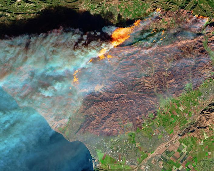 <p>The Multi Spectral Imager (MSI) on the European Space Agency's Sentinel-2 satellite captured the data for a false-color image of the burn scar – active fires appear orange, the burn scar is brown, unburned vegetation is green, and developed areas are gray. The Sentinel-2 image is based on observations of visible, shortwave infrared, and near infrared light, acquired Dec. 5, 2017. (Photo: NASA) </p>