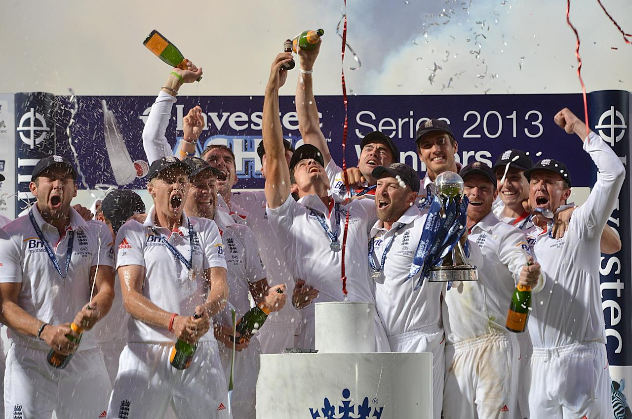 England celebrate as Alastair Cook lifts the Ashes Urn