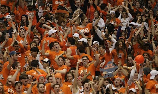 Syracuse fans celebrate after the team defeated Duke in an NCAA college basketball game in Syracuse, N.Y., Saturday, Feb. 1, 2014. Syracuse won 91-89. (AP Photo/Nick Lisi)
