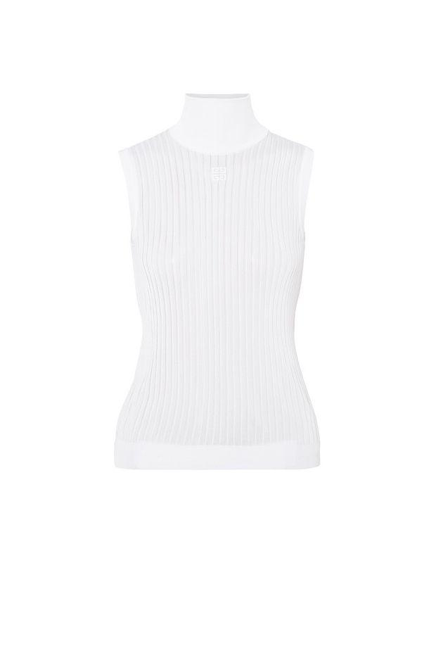 """<p>A sleeveless knit top in a neutral color is versatile enough to take you from breakfast in Piccadilly Square to getting lost in Selfridges to tea and scones at St. Christopher's Place. </p><p><em>Embroidered ribbed knitted turtleneck top, $850</em></p><a class=""""body-btn-link"""" href=""""https://go.redirectingat.com?id=74968X1596630&url=https%3A%2F%2Fwww.net-a-porter.com%2Fus%2Fen%2Fproduct%2F1098844%2FGivenchy%2Fembroidered-ribbed-knitted-turtleneck-top&sref=http%3A%2F%2Fwww.crfashionbook.com%2Ffashion%2Fg28196681%2Fwhat-to-wear-when-london-west-end-shopping-district%2F"""" target=""""_blank"""">SHOP</a>"""