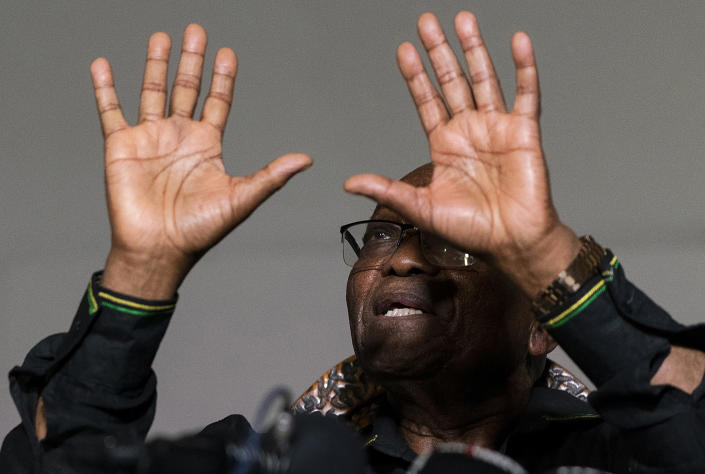 FILE - In this Sunday, July 4 2021, file photo former President Jacob Zuma gestures as he addresses the press at his home in Nkandla, KwaZulu-Natal Province, South Africa. Zuma left his home to hand himself over to authorities to serve a 15-month prison term Wednesday, July 7, 2021. (AP Photo/Shiraaz Mohamed, File)