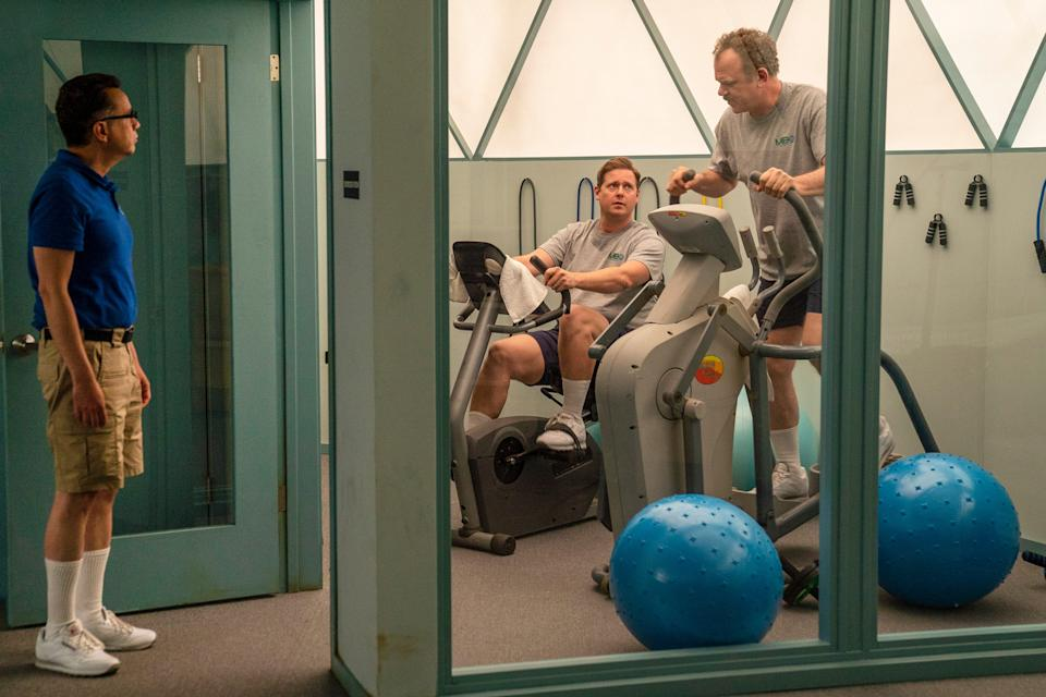 Astronaut hopefuls Skip (Fred Armisen), left, Rook (Tim Heidecker) and Cap (John C. Reilly) share a small gym in their isolated desert compound in the Showtime comedy, 'Moonbase 8.'