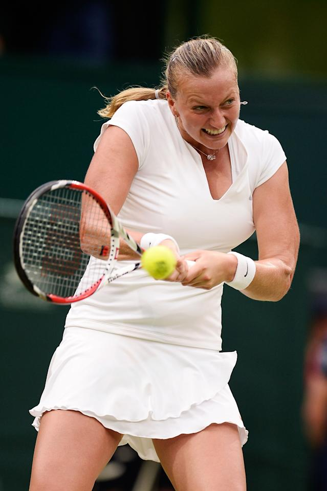 LONDON, ENGLAND - JULY 02: Petra Kvitova of Czech Republic plays a backhand during the Ladies' Singles quarter-final match against Kirsten Flipkens of Belgium on day eight of the Wimbledon Lawn Tennis Championships at the All England Lawn Tennis and Croquet Club at Wimbledon on July 2, 2013 in London, England. (Photo by Dennis Grombkowski/Getty Images)