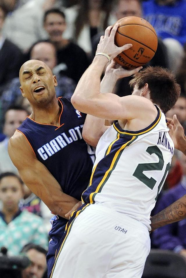 Charlotte Bobcats' Gerald Henderson, left, blocks Utah Jazz's Gordon Hayward (20 ) in the second quarter of an NBA basketball game Monday, Dec. 30, 2013, in Salt Lake City. (AP Photo/Gene Sweeney Jr.)