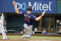 Minnesota Twins' Max Kepler (26) scores against the Texas Rangers during the seventh inning of a baseball game Saturday, June 19, 2021, in Arlington, Texas. (AP Photo/Michael Ainsworth)