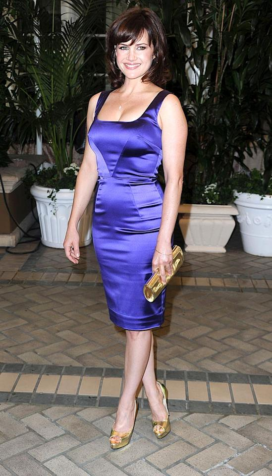 """Entourage's"" Carla Gugino donned a dark purple Dolce & Gabbana number and a flashy gold clutch and peep-toe heels. Do you give the look a thumbs up, or thumbs down? Frazer Harrison/<a href=""http://www.gettyimages.com/"" target=""new"">GettyImages.com</a> - July 28, 2010"