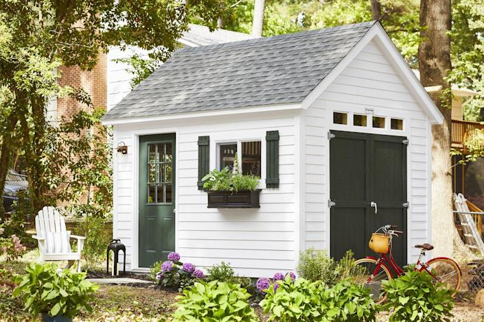 """<p>Coordinating with their home's color scheme, a new bespoke, Cape Cod–style storage shed by <a href=""""https://go.redirectingat.com?id=74968X1596630&url=https%3A%2F%2Fwww.homedepot.com%2Fs%2Ftuff%252520shed&sref=https%3A%2F%2Fwww.countryliving.com%2Fhome-design%2Fhouse-tours%2Fg36730466%2Fmakeover-takeover-backyard%2F"""" rel=""""nofollow noopener"""" target=""""_blank"""" data-ylk=""""slk:Tuff Shed"""" class=""""link rapid-noclick-resp"""">Tuff Shed</a> satisfies a little of Marcus's longing for life in New England and a lot of his desire to keep stuff out of the garage. </p><p><strong>Get the Look:</strong><br><strong>Shed: </strong><a href=""""https://go.redirectingat.com?id=74968X1596630&url=https%3A%2F%2Fwww.homedepot.com%2Fs%2Ftuff%252520shed&sref=https%3A%2F%2Fwww.countryliving.com%2Fhome-design%2Fhouse-tours%2Fg36730466%2Fmakeover-takeover-backyard%2F"""" rel=""""nofollow noopener"""" target=""""_blank"""" data-ylk=""""slk:&quot;Premier Pro Tall Ranch&quot; by Tuff Shed"""" class=""""link rapid-noclick-resp"""">""""Premier Pro Tall Ranch"""" by Tuff Shed</a><br><strong>Exterior Paint:</strong> <a href=""""https://www.sherwin-williams.com/homeowners/color/find-and-explore-colors/paint-colors-by-family/SW7008-alabaster"""" rel=""""nofollow noopener"""" target=""""_blank"""" data-ylk=""""slk:Alabaster by Sherwin-Williams"""" class=""""link rapid-noclick-resp"""">Alabaster by Sherwin-Williams</a><strong><br>Door and Shutter Paint:</strong> <a href=""""https://www.sherwin-williams.com/homeowners/color/find-and-explore-colors/paint-colors-by-family/SW0041-dard-hunter-green"""" rel=""""nofollow noopener"""" target=""""_blank"""" data-ylk=""""slk:Dard Hunter Green by Sherwin-Williams"""" class=""""link rapid-noclick-resp"""">Dard Hunter Green by Sherwin-Williams</a><strong><br>Outdoor </strong><strong>Sconce:</strong> <a href=""""https://www.lightology.com/index.php?module=prod_detail&prod_id=209554"""" rel=""""nofollow noopener"""" target=""""_blank"""" data-ylk=""""slk:Hubbardton Forge's &quot;Mason&quot; from Lightology"""" class=""""link rapid-noclick-resp"""">Hubbardton Forge's """"Mason"""" from Lightology</a><br><s"""