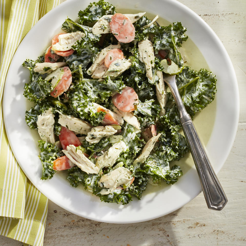 """<p>It's important to thinly slice the kale, otherwise it'll lead to a tough-to-chew salad. An easy way to do this is by stacking a few of the de-stemmed leaves on top of one other, rolling them into a cylinder, and thinly slicing the leaves. Serve leftovers on croissants, in collard green wraps, with garlic toast, or on their own.</p><strong><a rel=""""nofollow"""" href=""""http://www.myrecipes.com/recipe/green-goddess-chicken-salad-0"""">Recipe: Green Goddess Chicken Salad</a></strong>"""