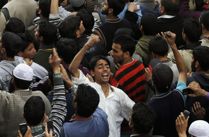 Kashmiri Muslims shout slogans near the coffin of Moulvi Showkat Ahmed Shah, the president of the religious group Jamiat-e-ahle Hadith, who was killed in a blast as he was entering a mosque in Srinagar, India, Friday, April 8, 2011. A blast outside a mosque in the Indian portion of Kashmir on Friday killed the prominent Muslim religious leader and wounded a bystander, police said. (AP Photo/Mukhtar Khan)