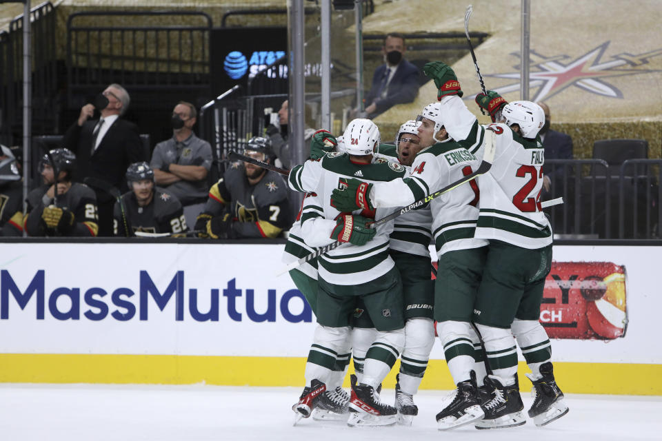 Minnesota Wild players celebrate a goal against the Vegas Golden Knights during the first period of Game 7 of an NHL hockey Stanley Cup first-round playoff series Friday, May 28, 2021, in Las Vegas. (AP Photo/Joe Buglewicz)