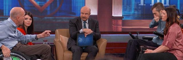Dr. Phil sitting between two interabled couples. Both male partners are in wheelchairs. Their female partners are sitting next to them.