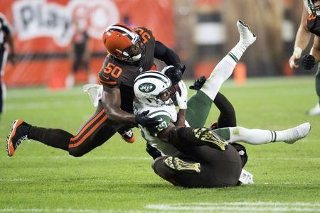 Sep 20, 2018; Cleveland, OH, USA; New York Jets running back Bilal Powell (29) is tackled by Cleveland Browns defensive tackle Larry Ogunjobi (65) and defensive end Chris Smith (50) during the first half at FirstEnergy Stadium. Mandatory Credit: Ken Blaze-USA TODAY Sports
