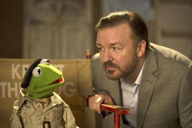"This image released by Disney shows the muppet character Kermit the frog, left, and Ricky Gervais in a scene from ""Muppets Most Wanted."" (AP Photo/Disney Enterprises, Inc., Jay Maidment, file)"