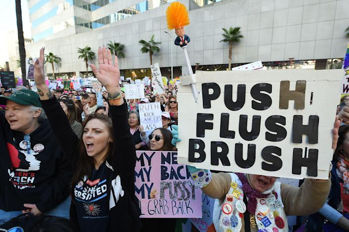 Protesters hold signs during the Women's March on Jan. 19, 2019 in Los Angeles, Calif. (Photo: Robyn Beck/AFP/Getty Images)