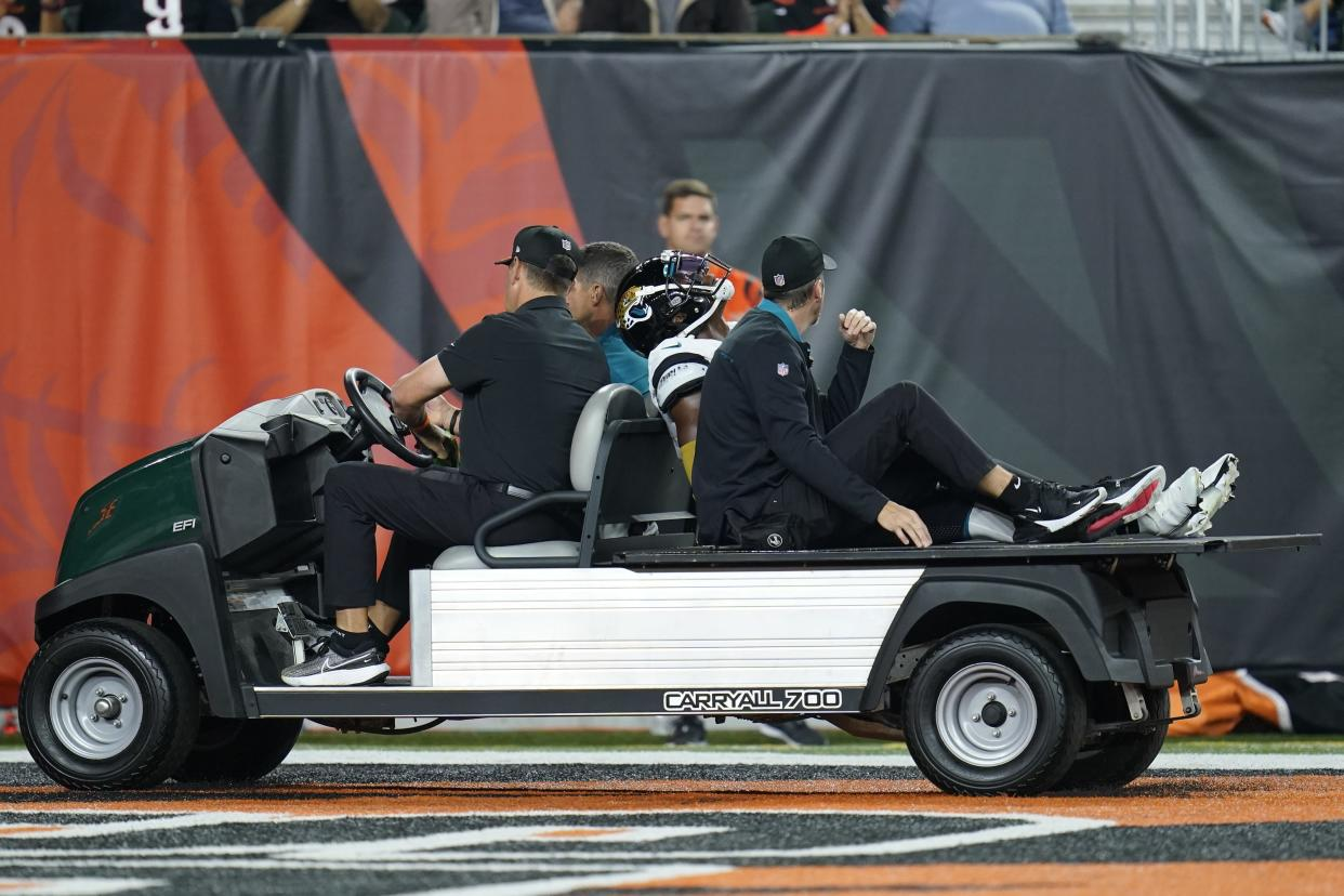 Jacksonville Jaguars' D.J. Chark is carted off the field during the first half of an NFL football game against the Cincinnati Bengals, Thursday, Sept. 30, 2021, in Cincinnati. (AP Photo/Michael Conroy)