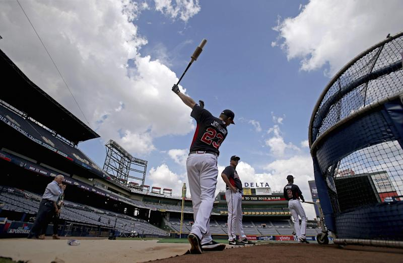 Atlanta Braves third baseman Chris Johnson (23) takes some practice swings before batting practice Wednesday, Oct. 2, 2013, in Atlanta. Game 1 of baseball's NL division series between the Braves and the Los Angeles Dodgers is scheduled for Thursday. (AP Photo/Atlanta Journal Constitution, Jason Getz) MARIETTA OUT GWINNETT OUT LOCAL TV OUT (WXIA, WGCL, FOX 5)