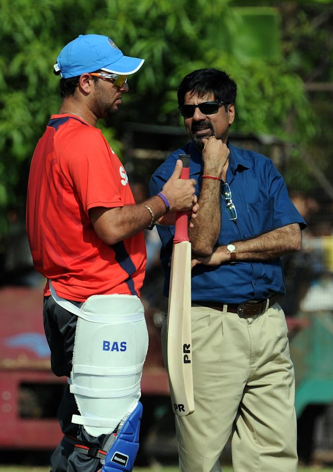 India's batsman Yuvraj Singh (L) listens to Board of Control for Cricket in India (BCCI) selection committee chairman Krishnamachari Srikkanth during a team training session at the Indian Institute of Technology (IIT) grounds in Chennai on March 17, 2011. India will play the West Indies in Match 42 of the continuing Cricket World Cup 2011 on March 20 in Chennai. AFP PHOTO / Prakash SINGH